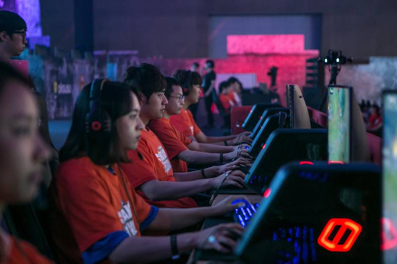 Gamers of the SK Telecom professional video-game team, sponsored by SK Telecom Co., play the League of Legends game during a tournament at the 5GX Game Festival in Goyang, South Korea, on Friday, Aug. 10, 2018. Professional video gaming began in South Korea more than a decade ago, and has given rise to leagues that now pack stadiums and draw hundreds of thousands of eyeballs toTwitch livestreamsfor tournaments. Photographer: Jean Chung/Bloomberg