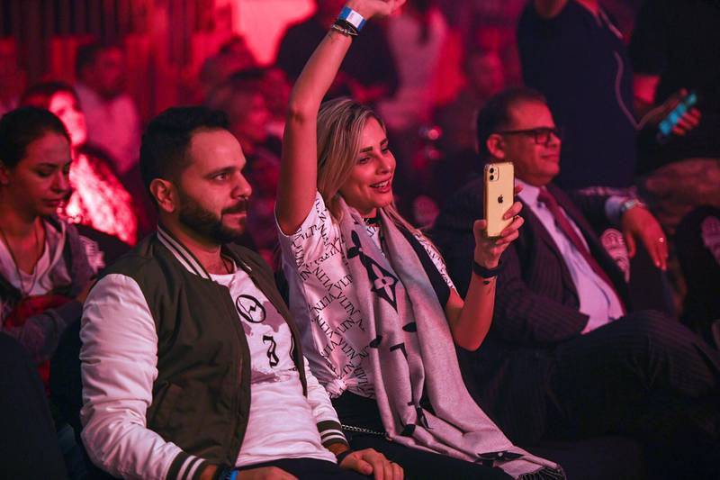 Abu Dhabi, United Arab Emirates - Fans cheer on their respective fighters at the UAE Warriors Fighting Championship in Mubadala Arena, Zayed Sports City. Khushnum Bhandari for The National