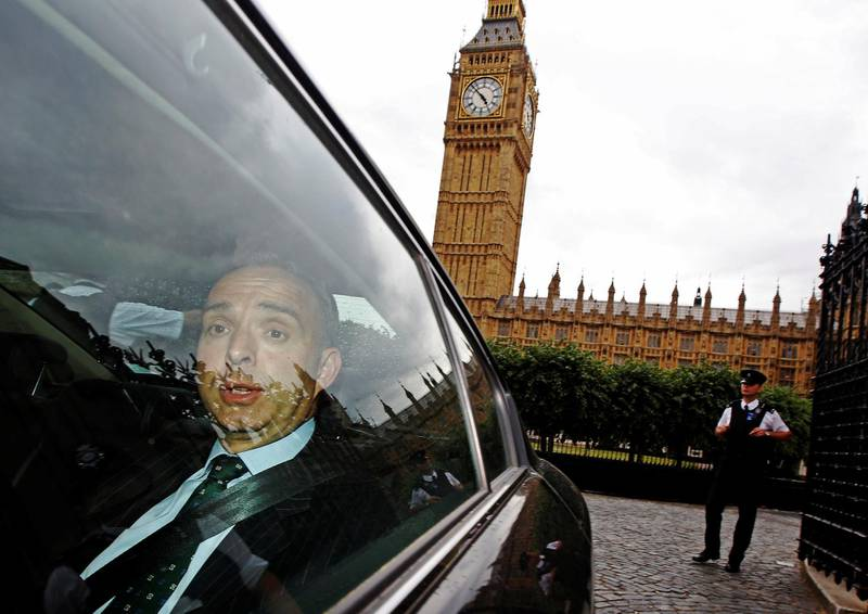 FILE PHOTO: Mark Sedwill, the top civil servant at Britain's Home Office leaves the Houses of Parliament after giving evidence at a Commons Home Affairs Select Committee hearing in London July 8, 2014.  REUTERS/Luke MacGregor/File Photo