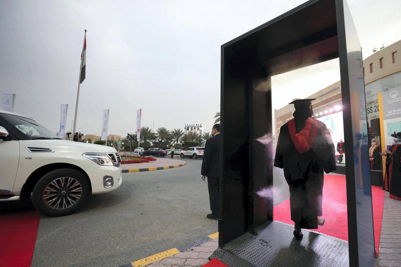 Ajman, United Arab Emirates - Reporter: Anam Rizvi. News. Students go through a sterilisation booth during their drive through graduation from Ajman University because of Covid-19. Wednesday, February 10th, 2021. Ajman. Chris Whiteoak / The National