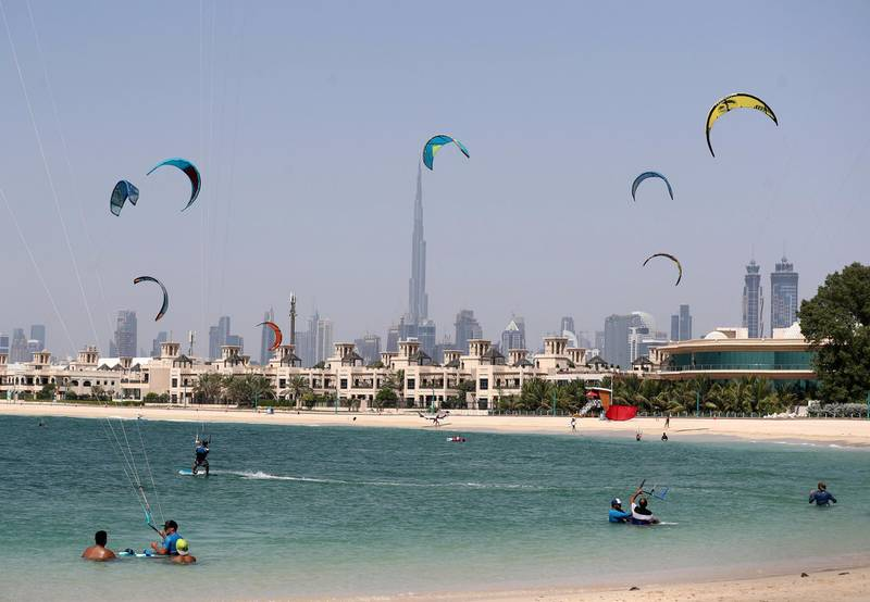 Dubai, United Arab Emirates - Reporter: N/A. News. Standalone. Kite surfers fill the sky as people go to the beach on a hot day in Dubai. Monday, June 22nd, 2020. Jumeriah, Dubai. Chris Whiteoak / The National