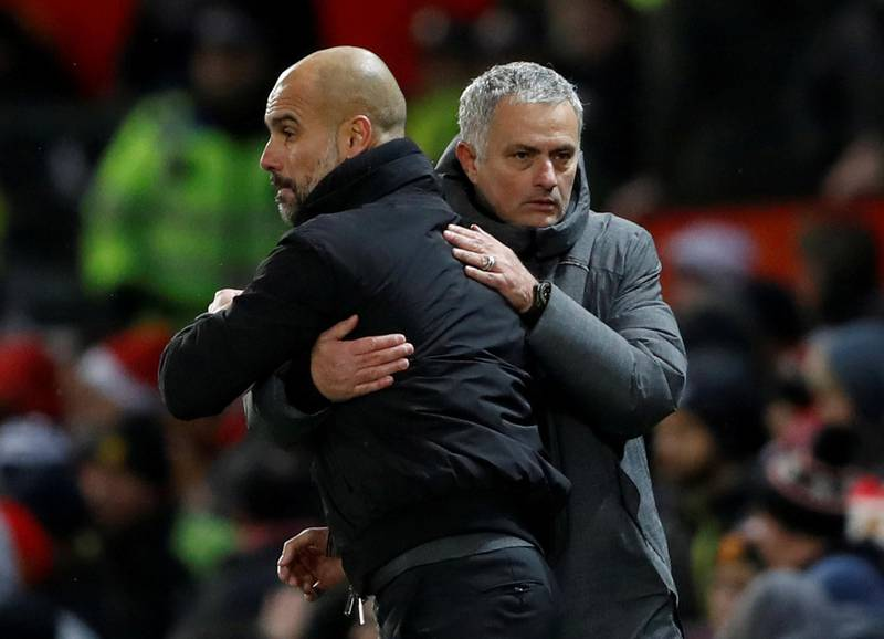"""FILE PHOTO: Soccer Football - Premier League - Manchester United vs Manchester City - Old Trafford, Manchester, Britain - December 10, 2017   Manchester City manager Pep Guardiola and Manchester United manager Jose Mourinho at the end of the match                               Action Images via Reuters/Carl Recine    EDITORIAL USE ONLY. No use with unauthorized audio, video, data, fixture lists, club/league logos or """"live"""" services. Online in-match use limited to 75 images, no video emulation. No use in betting, games or single club/league/player publications. Please contact your account representative for further details./File Photo"""
