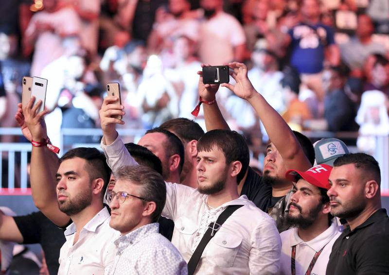 Abu Dhabi, United Arab Emirates - September 07, 2019: Fight fans take pics. Welterweight bout between Belal Muhammad and Takashi Satō in the Early Prelims at UFC 242. Saturday the 7th of September 2019. Yas Island, Abu Dhabi. Chris Whiteoak / The National