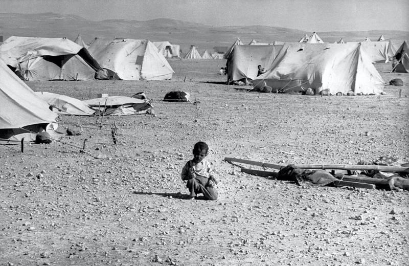 A Palestinian child plays 23 June 1967 in a refugee camp in Jordan. The June 1967 war was a stunning military victory for Israel, but the start of a political stalemate that continues to this day. During the Six-Day War Israel suffered around 700 fatalities, while estimates of the numbers of Arabs killed range from just over 11,000 to 21,000, with losing the Egyptians paying the heaviest tribute. Israel was left in control of the Sinai, the Gaza Strip, the West Bank and East Jerusalem and the Golan Heights. Some 350,000 Palestinians fled the newly occupied regions to take up residence in neighbouring states. Most of them have never been able to return, and are still living in refugee camps. (Photo by AFP)