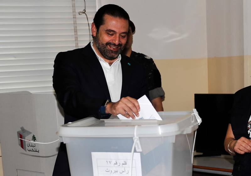 Lebanese Prime Minister Saad Hariri, casts his vote for Lebanon's parliamentary elections, at a polling station, in Beirut, Lebanon, Sunday, May 6, 2018. Lebanon's polling stations have opened for the first parliamentary elections in nine years. (AP Photo/Hussein Malla)