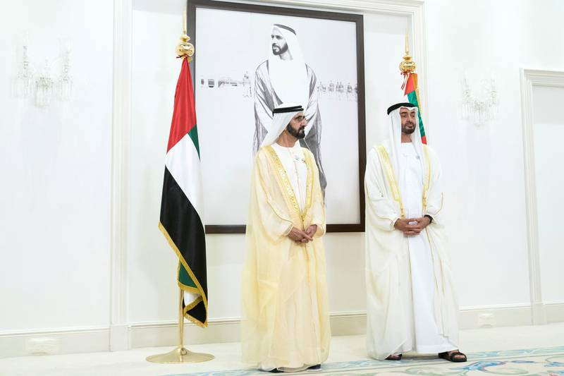 ABU DHABI, UNITED ARAB EMIRATES - June 15, 2018: HH Sheikh Mohamed bin Zayed Al Nahyan Crown Prince of Abu Dhabi Deputy Supreme Commander of the UAE Armed Forces (R) and HH Sheikh Mohamed bin Rashid Al Maktoum, Vice-President, Prime Minister of the UAE, Ruler of Dubai and Minister of Defence (L), participate in a live video call with UAE Armed Forces in Yemen during an Eid Al Fitr reception at Mushrif Palace.    ( Mohamed Al Hammadi / Crown Prince Court - Abu Dhabi ) ---