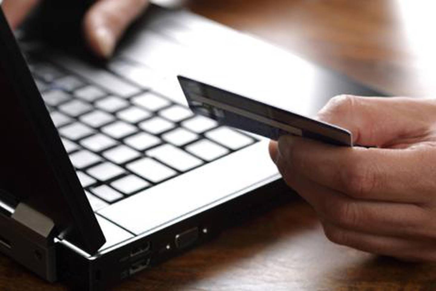 Person with credit card using a computer for internet shopping. istockphoto.com