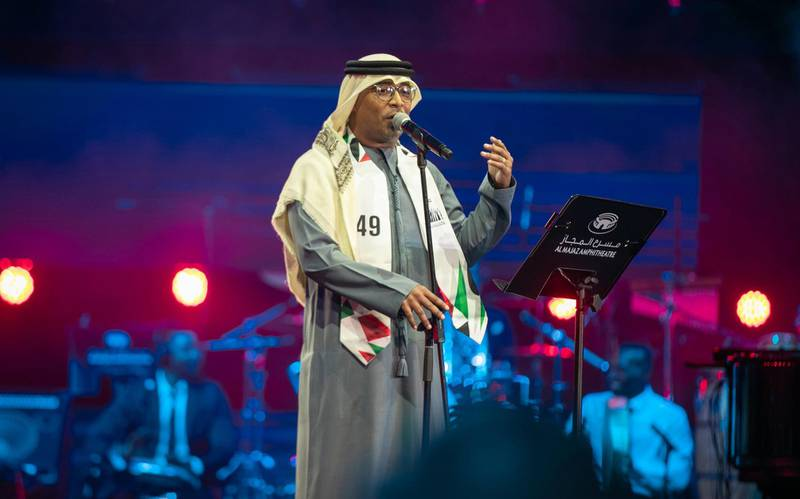 Emirati singer Jassim Mohammed performs at the 49th National Day show at Al Majaz Amphitheatre in Sharjah, December 3. Wam