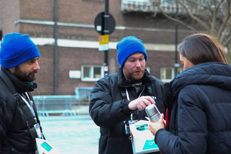 Liam and Danny, fundraisers for TAP London, a company that employs homeless people to raise money for homeless charities via contactless payments, speak to a passer-by in London United Kingdom on January 4, 2018. Thomson Reuters Foundation / Cormac O'Brien