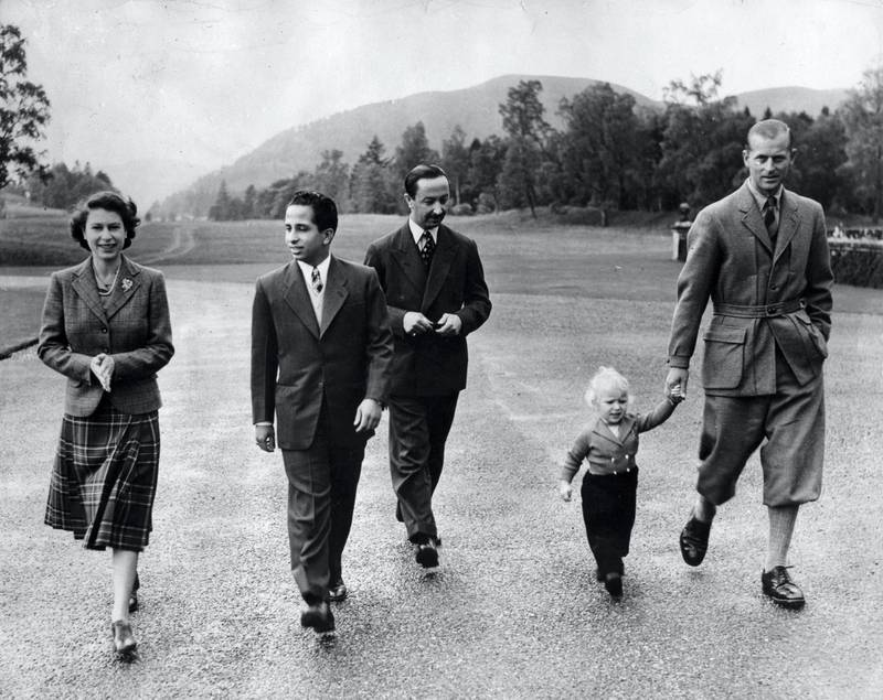 Queen Elizabeth II, wearing a tartan skirt and tweed jacket outside Balmoral Castle with her Royal visitors, King Faisal II and the Regent of Iraq, the Duke of Edinburgh, and Princess Anne.   (Photo by PA Images via Getty Images)