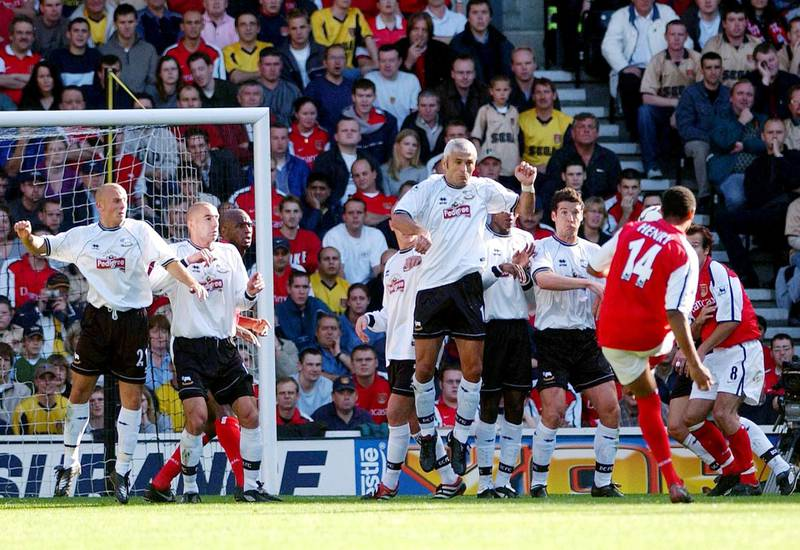 Thierry Henry scores Arsenal's first goal against Derby 29 September 2001 in Derby during their English Premier League match. AFP PHOTO ROGER PARKER (Photo by ROGER PARKER / AFP)
