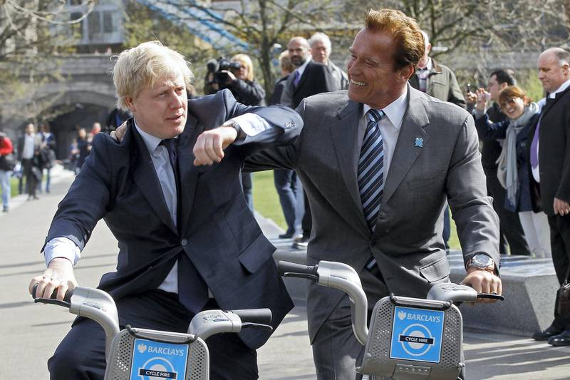 Former California Governor, Arnold Schwarzenegger (R), and London Mayor Boris Johnson  pose for photographers, in London March 31, 2011.    REUTERS/Stefan Wermuth (BRITAIN - Tags: ENTERTAINMENT POLITICS)