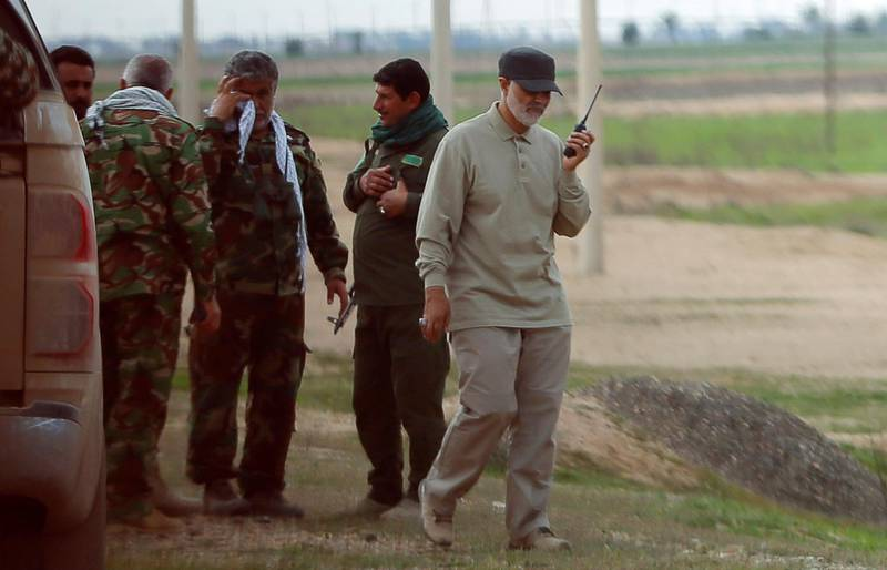 Iranian Revolutionary Guard Commander Qassem Soleimani uses a walkie-talkie at the frontline during offensive operations against Islamic State militants in the town of Tal Ksaiba in Salahuddin province March 8, 2015. Picture taken March 8, 2015.   REUTERS/Stringer (IRAQ - Tags: CIVIL UNREST CONFLICT POLITICS)