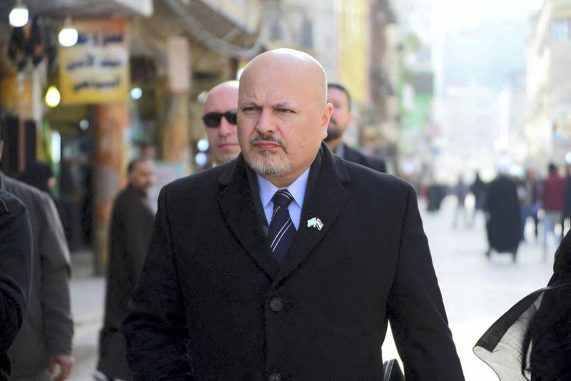 British lawyer Karim Asad Ahmad Khan walks in the streets of the holy city of Najaf in central Iraq during his visit to the war-torn country's Shiite Muslim Grand Ayatollah Ali Sistani on January 23, 2019. - Khan, an ex defence lawyer of Liberian former President Charles Taylor, heads a United Nations team authorized over a year ago to investigate the massacre of the Yazidi minority and other atrocities by jihadists in Iraq.  The UN Security Council adopted a resolution in September 2017 to bring those responsible for Islamic State group war crimes to justice -- a cause championed by Nobel Peace Prize winner Nadia Murad and international human rights lawyer Amal Clooney. (Photo by Haidar HAMDANI / AFP)