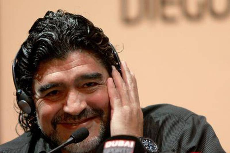 Argentine football legend Diego Maradona speaks during a press conference in Dubai, on June 04, 2011 as he was introduced as the new coach of the al-Wasel football club. Maradona will train al-Wasel for two years.       AFP PHOTO/MARWAN NAAMANI