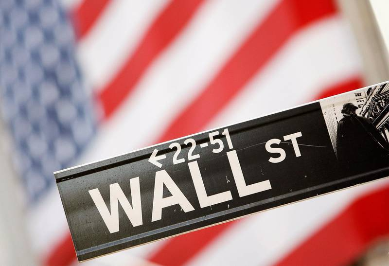 FILE PHOTO: A Wall Street sign is seen outside the New York Stock Exchange, September 30, 2008.  REUTERS/Lucas Jackson/File Photo