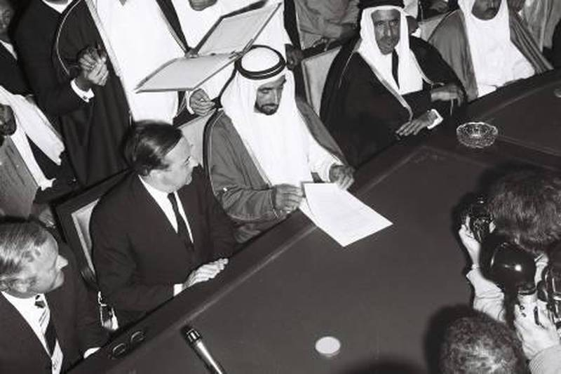 """History Project 2010, """"The First Day"""". The signing and speech at Union House, Dubai. December 2, 1971. Sheikh Zayed reads the treaty of friendship watched by (from left) James Treadwell and Sir Geoffrey Arthur of Britain. On his other side are Shiekh Rashid of Dubai and Sheikh Khalid of Sharjah. Behind him are Ahmed al Suwaidi, Mahdi al Tajir and Shiekh Maktoum bin Rashid.  Credit Ittihad Newspaper **EDS NOTE ***IMPORTANT** SEEK ADVISE FROM KAREN BEFORE USE"""
