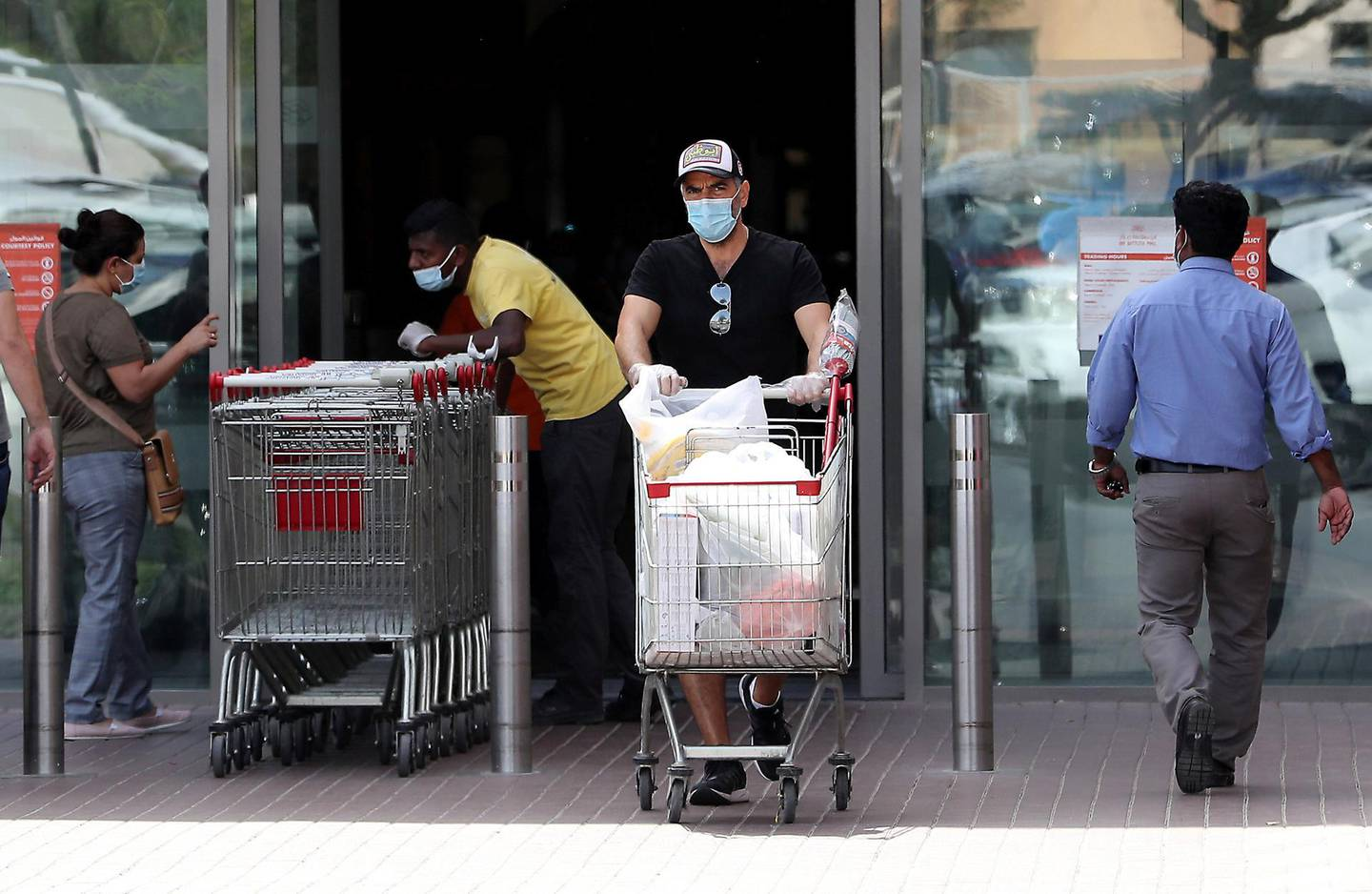 DUBAI, UNITED ARAB EMIRATES , April 05 – 2020 :- One of the shopper with protective face mask after doing shopping at the Carrefour supermarket in Ibn Battuta mall in Dubai. UAE government told residents to wear facemask and gloves all the times outside the home. (Pawan Singh / The National) For News/Online/Instagram.