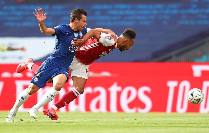 Chelsea's Spanish defender Cesar Azpilicueta (L) fouls Arsenal's Gabonese striker Pierre-Emerick Aubameyang to conceed a penalty during the English FA Cup final football match between Arsenal and Chelsea at Wembley Stadium in London, on August 1, 2020.  - NOT FOR MARKETING OR ADVERTISING USE / RESTRICTED TO EDITORIAL USE   / AFP / POOL / Catherine Ivill / NOT FOR MARKETING OR ADVERTISING USE / RESTRICTED TO EDITORIAL USE