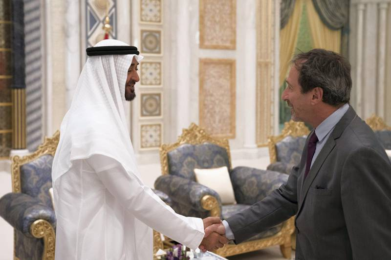 ABU DHABI, UNITED ARAB EMIRATES - May 20, 2018: HH Sheikh Mohamed bin Zayed Al Nahyan Crown Prince of Abu Dhabi Deputy Supreme Commander of the UAE Armed Forces (L), receives HE Fernando Ramon de Martini, Ambassador of Argentina to the UAE (R), during an iftar reception at the Presidential Palace.   ( Hamad Al Kaabi / Crown Prince Court - Abu Dhabi ) ---