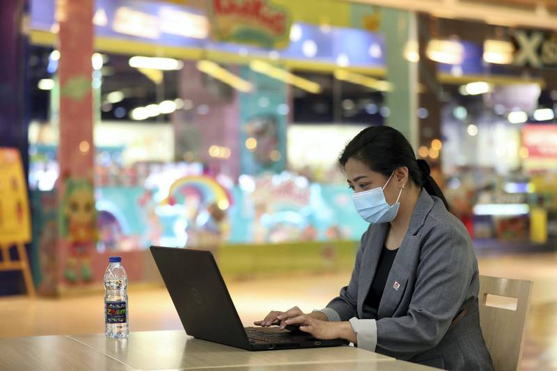 Dubai, United Arab Emirates - Reporter: N/A. News. Coronavirus/Covid-19. A lady works on her laptop while wearing a mask at Times Square in Dubai. Tuesday, October 20th, 2020. Dubai. Chris Whiteoak / The National