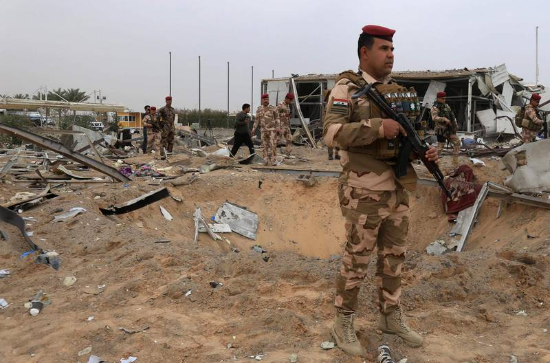 A picture taken on March 13, 2020 shows destruction at Karbala airport in the Iraqi shrine city, one of the areas targeted by US military air strikes against a pro-Iranian group in Iraq following the deaths of two Americans and a Briton in a rocket attack the previous night on a US base in Taji. The US operation targeted five weapons facilities of the Kataeb Hezbollah armed faction across Iraq, the Pentagon said in a statement, one of them in Karbala, south of Baghdad. Wednesday's attack on the Taji air base was the 22nd on US installations in Iraq, including the American embassy, since late October. While there was no immediate claim of responsibility, Washington has blamed Iran-backed factions from the Hashed al-Shaabi network, a state-sponsored umbrella group that includes Kataeb Hezbollah, for recent similar violence.  / AFP / Mohammed SAWAF
