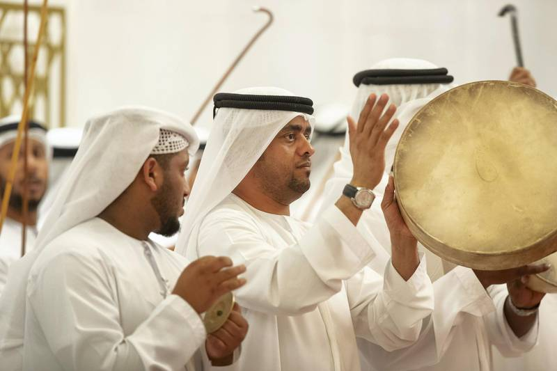 ABU DHABI, UNITED ARAB EMIRATES - February 3, 2019: Day one of the UAE papal visit - A Traditional Ayala dance is performed during the arrival of His Holiness Pope Francis, Head of the Catholic Church(not shown), and His Eminence Dr Ahmad Al Tayyeb, Grand Imam of the Al Azhar Al Sharif (not shown), at Presidential Airport.  ( Ryan Carter / Ministry of Presidential Affairs ) ---