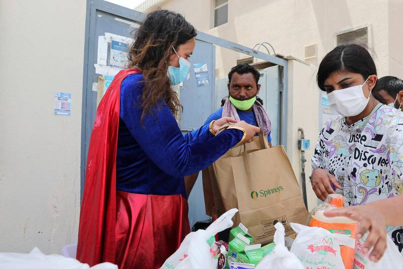 Ibtihal Makmahi-Tarik. Women dressed as superheroes handed out food, water, toiletries and water bottles at a labour camp in Al Quoz, Dubai on June 25th, 2021. Chris Whiteoak / The National.  Reporter: N/A for News