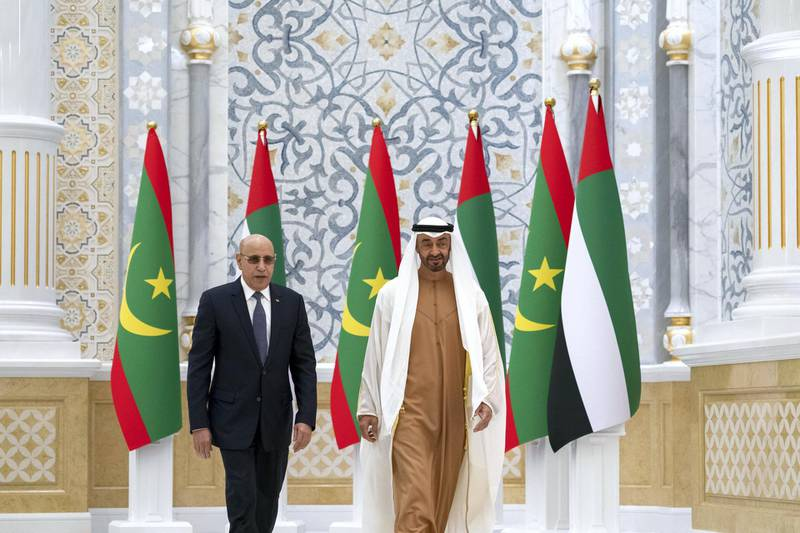 ABU DHABI, UNITED ARAB EMIRATES - February 02, 2020: HH Sheikh Mohamed bin Zayed Al Nahyan, Crown Prince of Abu Dhabi and Deputy Supreme Commander of the UAE Armed Forces (R) receives HE Mohamed Ould Ghazouani, President of Mauritania (L), during an official reception, at Qasr Al Watan.   ( Mohamed Al Hammadi / Ministry of Presidential Affairs ) ---