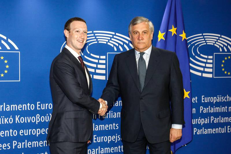 Mark Zuckerberg, chief executive officer and founder of Facebook Inc., left, shakes hands with Antonio Tajani, president of the European Parliament, as he arrives to testify at the European Union (EU) parliament in Brussels, Belgium, on Tuesday, May 22, 2018. Zuckerberg will tout the company's investment in Europe and again take responsibility for privacy failures, according to testimony prepared for an appearance Tuesday in front of the region's parliament. Photographer: Dario Pigantelli/Bloomberg