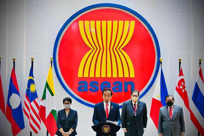 """This handout photograph taken on April 24, 2021 and released by the Indonesian Presidential Palace shows Indonesian President Joko Widodo (C) delivering his speech at the Association of Southeast Asian Nations (ASEAN), Myannmar crisis talks in Jakarta. RESTRICTED TO EDITORIAL USE - MANDATORY CREDIT """"AFP PHOTO/Indonesian Presidential Palace"""" - NO MARKETING - NO ADVERTISING CAMPAIGNS - DISTRIBUTED AS A SERVICE TO CLIENTS  / AFP / INDONESIAN PRESIDENTIAL PALACE / - / RESTRICTED TO EDITORIAL USE - MANDATORY CREDIT """"AFP PHOTO/Indonesian Presidential Palace"""" - NO MARKETING - NO ADVERTISING CAMPAIGNS - DISTRIBUTED AS A SERVICE TO CLIENTS"""