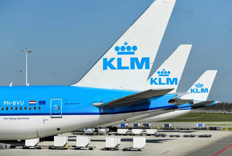 FILE PHOTO: KLM airplanes are seen parked at Schiphol Airport in Amsterdam, Netherlands, April 2, 2020. REUTERS/Piroschka van de Wouw/File Photo/File Photo