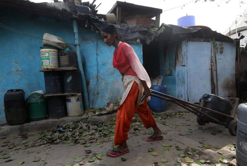 epa06833340 An Indian woman pulls a container after filling up with water from a tanker in Sanjay camp in New Delhi, India, 23 June 2018. National Institution for Transforming India(NITI), a policy think tank of the Government of India has warned that New Delhi will run out of water within two years due to the climate change and population growth. NITI has also warned that Indian states are going to face water crisis by 2020, which includes Major cities like New Delhi and Bangalore. India's worst ever water crisis is expected to adversely impact around 600 million people.  EPA/RAJAT GUPTA
