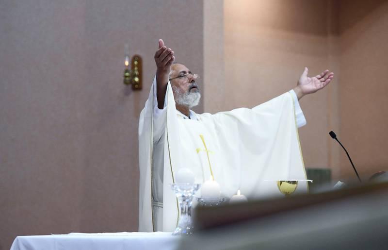 Abu Dhabi, United Arab Emirates - Father Habib, guest from Pakistan conducts 8am Christmas mass at St. JosephÕs Cathedral, Mushrif. Khushnum Bhandari for The National