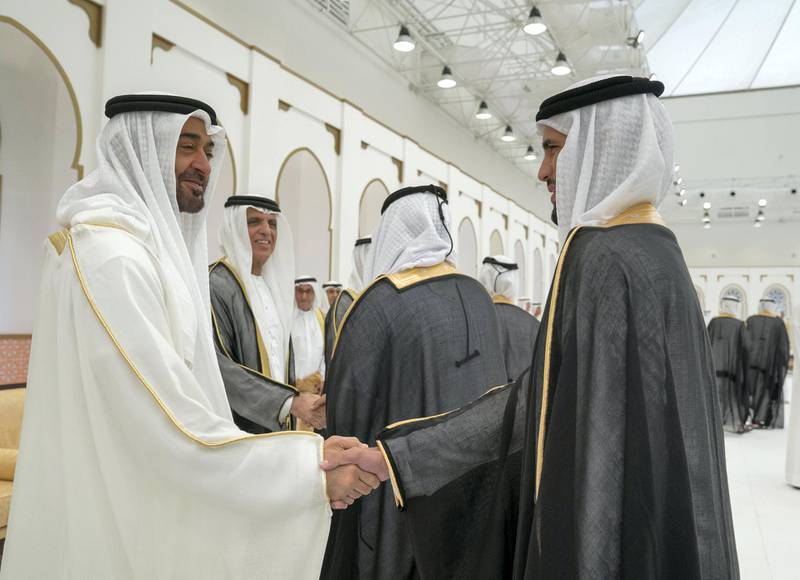 ADHAN, RAS AL KHAIMAH, UNITED ARAB EMIRATES - March 13, 2018: HH Sheikh Mohamed bin Zayed Al Nahyan, Crown Prince of Abu Dhabi and Deputy Supreme Commander of the UAE Armed Forces (L), greets a groom who participated in a mass wedding reception for HH Sheikh Mohamed bin Saud bin Saqr Al Qasimi, Crown Prince and Deputy Ruler of Ras Al Khaimah (not shown), at Mohamed bin Zayed, Al Bayt Mitwahid wedding hall. Seen with HH Sheikh Saud bin Saqr Al Qasimi, UAE Supreme Council Member and Ruler of Ras Al Khaimah (2nd L).  ( Mohamed Al Hammadi / Crown Prince Court - Abu Dhabi ) ---