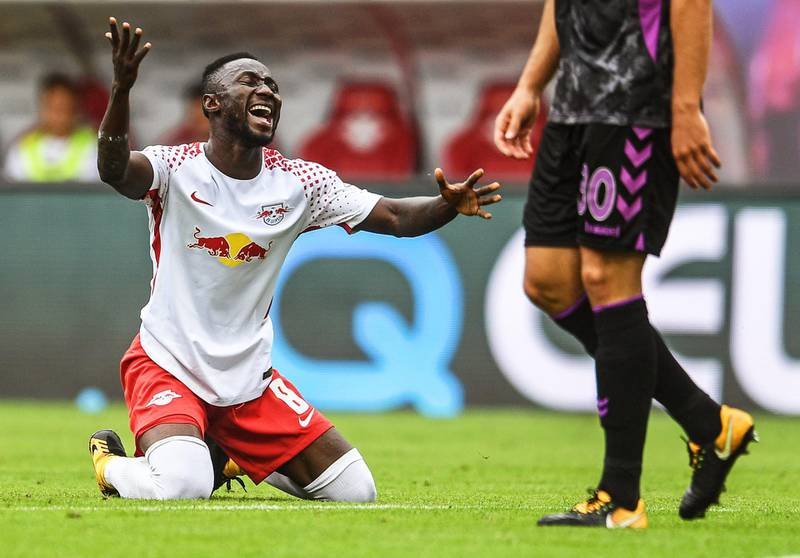 epa06166394 Leipzig's Naby Keita reacts during the German Bundesliga soccer match between RB Leipzig and SC Freiburg in Leipzig, Germany, 27 August 2017.  EPA/FILIP SINGER EMBARGO CONDITIONS - ATTENTION: Due to the accreditation guidelines, the DFL only permits the publication and utilisation of up to 15 pictures per match on the internet and in online media during the match.