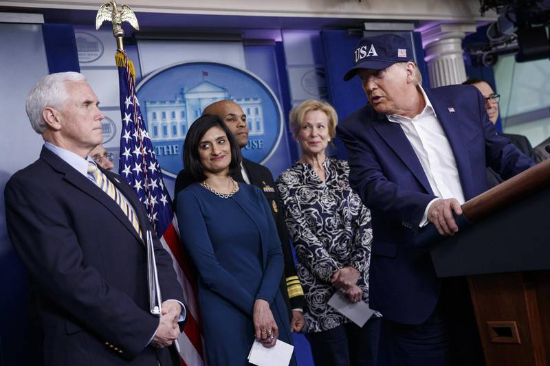 U.S. President Donald Trump, right, looks at U.S. President Mike Pence while answering a question during a news conference in the briefing room of the White House in Washington, D.C., U.S., on Saturday, March 14, 2020. Trump said he took a test to determine whether he has coronavirus, days after learning that he's come in contact with people who were infected or are concerned they've got the virus. Photographer: Shawn Thew/EPA/Bloomberg
