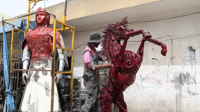 An image that illustrates this article From auto-scrap to art: Tunisian artist creates sculptures from car parts