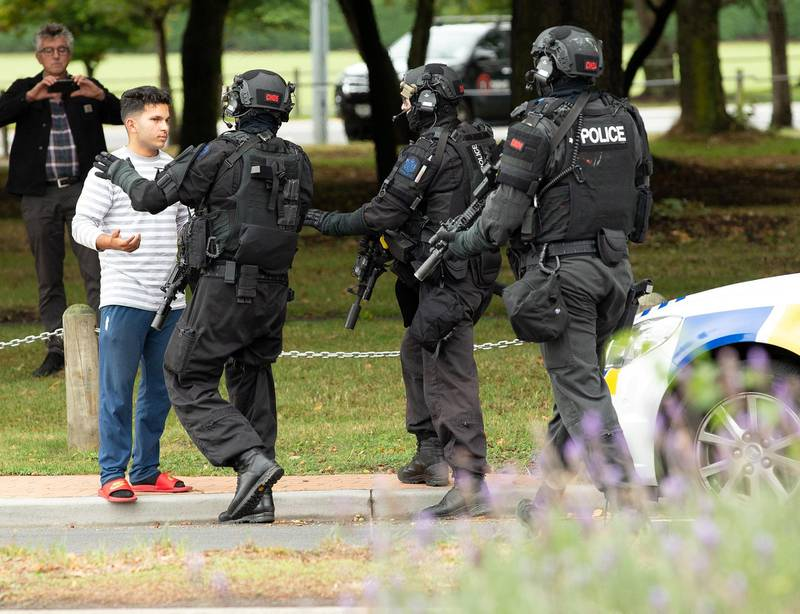 epaselect epa07438177 AOS (Armed Offenders Squad) push back members of the public following a shooting resulting in multiple fatalies and injuries at the Masjid Al Noor on Deans Avenue in Christchurch, New Zealand, 15 March 2019. According to media reports on 15 March 2019, a gunman opened fire at around 1:40 pm local time after walking into the mosque, killing at least six people. Armed police officers were deployed to the scene, along with emergency service personnel.  Local authorities have advised residents to stay indoors as the situation is evolving. Four people are in custody in connection with the shooting, and other possible perpetrators are reportedly still at large. There have been confirmed reports of a shooting at a second mosque in Christchurch.  EPA-EFE/Martin Hunter NEW ZEALAND OUT *** Local Caption *** 55055617