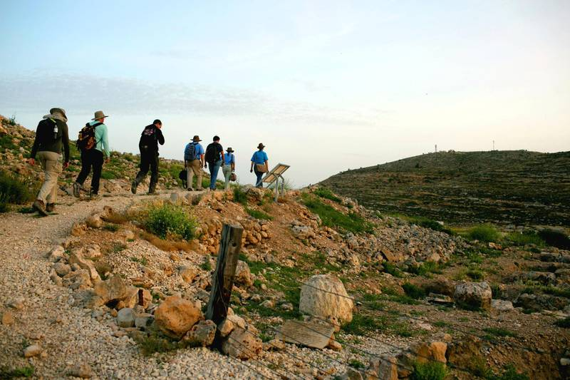 Members of the Associates for Biblical Research, march towars their excevaiton sight, during the early hours of the morning, near Shilo, West Bank.
