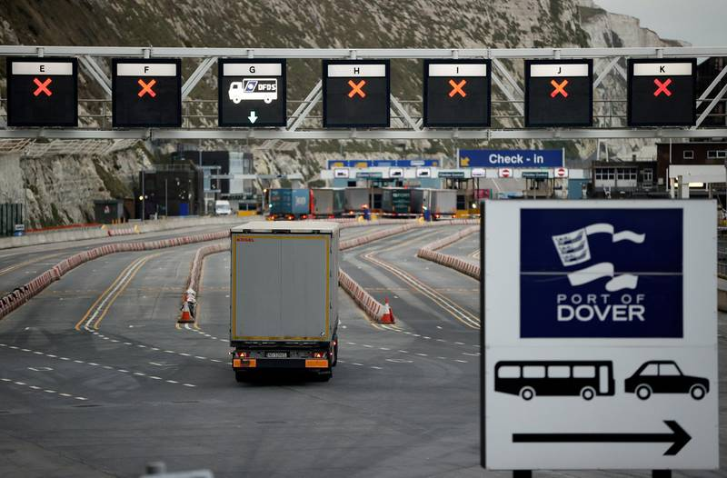 FILE PHOTO: A truck drives towards the entrance to the Port of Dover, following the end of the Brexit transition period, in Dover, Britain, January 15, 2021. REUTERS/John Sibley//File Photo