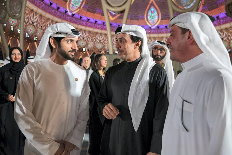 DUBAI, UNITED ARAB EMIRATES - January 29, 2020: HH Sheikh Mansour bin Zayed Al Nahyan, UAE Deputy Prime Minister and Minister of Presidential Affairs (C) and HH Sheikh Hamdan bin Mohamed Al Maktoum, Crown Prince of Dubai (L), attend the opening of Al Wasal Plaza at Expo 2020 Dubai site.  ( Mohamed Al Hammadi / Ministry of Presidential Affairs ) ---