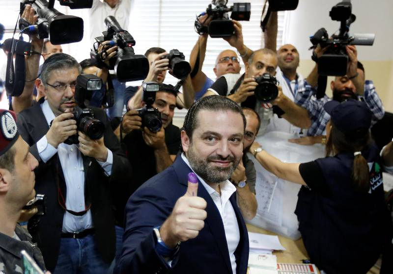Lebanese prime minister and candidate for the parliamentary election Saad al-Hariri shows his ink-stained finger after casting his vote in Beirut, Lebanon, May 6, 2018. REUTERS/Jamal Saidi