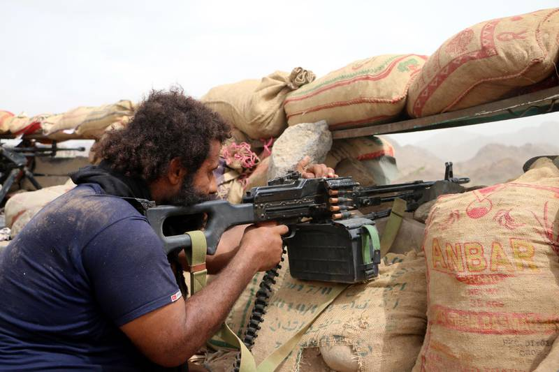 epa06912153 A member of Yemeni government forces fires a heavy machine gun during an offensive against Houthi positions on the outskirts of the western port city of Hodeidah, Yemen, 26 July 2018. According to reports, Yemen has been engulfed in a violent conflict between the Saudi-backed government and Houthi rebels since 2015, while UN Special Envoy to Yemen Martin Griffiths tires to push for a deal with Houthi militia leaders to cede control of the Red Sea port of Hodeidah to a UN-supervised committee, in an attempt to end the Saudi-led coalition assault on Hodeidah city.  EPA/NAJEEB ALMAHBOOBI
