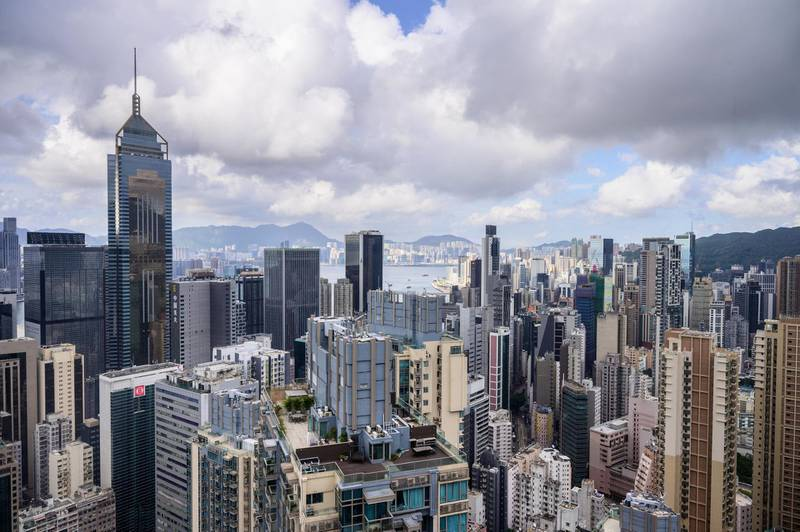 A general view shows residential and commercial buildings on Hong Kong island (foreground) and Kowloon (background) separated by Victoria Harbour in Hong Kong on May 11, 2021. (Photo by Anthony WALLACE / AFP)