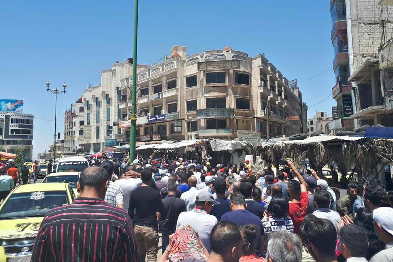"""A handout picture released by the local news site Suwayda 24 shows Syrians chanting anti-government slogans as they protest the country's deteriorating economic conditions and corruption, in the southern city of Suwaida on June 9, 2020.  - == RESTRICTED TO EDITORIAL USE - MANDATORY CREDIT """"AFP PHOTO / HO / SUWAIDA24"""" - NO MARKETING NO ADVERTISING CAMPAIGNS - DISTRIBUTED AS A SERVICE TO CLIENTS ==  / AFP / SUWAYDA24 / - / == RESTRICTED TO EDITORIAL USE - MANDATORY CREDIT """"AFP PHOTO / HO / SUWAIDA24"""" - NO MARKETING NO ADVERTISING CAMPAIGNS - DISTRIBUTED AS A SERVICE TO CLIENTS =="""