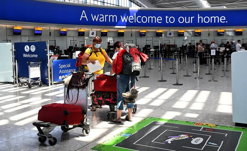 epa09254984 Travellers at Heathrow airport in London, Britain, 08 June 2021. Extra flights to Britain have been departing Portugal as holidaymakers scrambled to leave on the last day before the country moved to the amber travel list. Many travellers missed the deadline and will have to quarantine for up to ten days.  EPA/ANDY RAIN