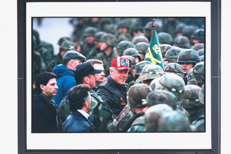 Pres. Bill Clinton (C) amid crowd of US soldiers, visiting troops on peacekeeping mission, enforcing provisions of Dayton, US-brokered peace accord in civil war-torn former Yugoslav republic.  (Photo by Diana Walker//The LIFE Images Collection via Getty Images)