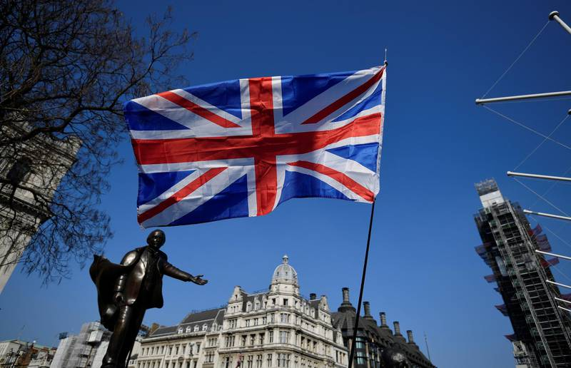 A British flag flutters during the March to Leave demonstration in Parliament square in London, Britain March 29, 2019. REUTERS/Toby Melville