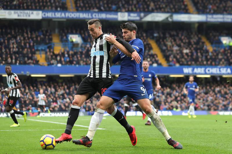 Chelsea's Spanish striker Alvaro Morata (R) pressures Newcastle United's Spanish midfielder Javier Manquillo (L) during the English Premier League football match between Chelsea and Newcastle United at Stamford Bridge in London on December 2, 2017. / AFP PHOTO / Daniel LEAL-OLIVAS / RESTRICTED TO EDITORIAL USE. No use with unauthorized audio, video, data, fixture lists, club/league logos or 'live' services. Online in-match use limited to 75 images, no video emulation. No use in betting, games or single club/league/player publications.  /